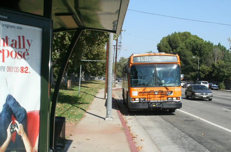 The Metro Local line 166 bus picks up passengers at the corner of Nordhoff Street and Lindley Avenue. Photo Credit: Charlie Landon / Staff Photographer