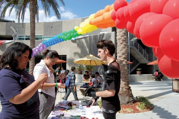 Over a hundred students attended the National Coming Out Day hosted by the Lesbian Gay Bisexual Transgender Alliance (LGBTA) on Wednesday at the Plaza Del Sol courtyard. Students were able to make rainbow necklaces and pin rainbow ribbons on their clothes to show support on the day's celebration. Photo Credit: Jacky Guerrero / Online Editor