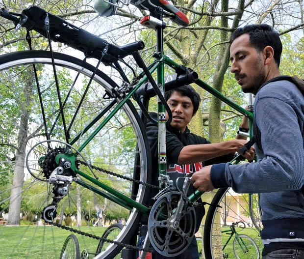Carlos Sapon (left), 18, history major and Esteban Rivas, 25, political science major are a part of CSUN Bike Collective. A.S. provides the club with $700 so that they can have weekly bike clinics and fix CSUN students bikes for free. Photo credit: John Saringo-Rodriguez / Daily Sundial
