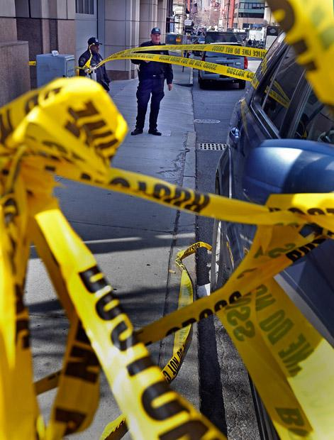"Yellow tape blocks the access to Exerter Street on Tuesday, April 16, 2013, in Boston, Massachusetts. The city is in mourning today for three killed and at least 144 wounded in a ""cowardly"" bombing at the Boston Marathon. (Nancy Lane/Boston Herald/MCT)"