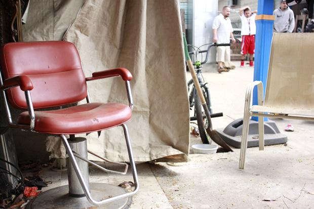 Romo first started cutting hair in the backyard of his family's home six years ago in a makeshift barber shop covered with a canopy. One of his first big purchases while he began cutting hair was this red barber chair.
