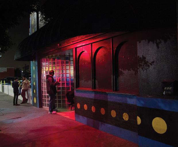 The exterior of Blipsy Barcade, on Western Ave. in Korea Town, is unusually nondescript, especially in the day time. A row of Pac-Dots line the brick wall giving away what awaits inside. The day-glo pink light mimics the interior arcade machine's color cascade from rows of stand-up cabinets.