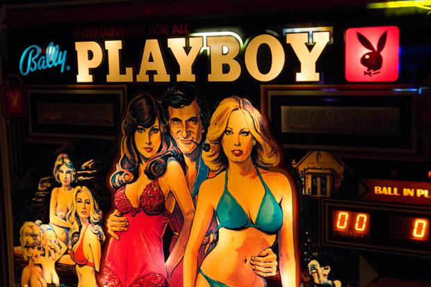The glass marquises of both pinball and cabinet games were the main advertising for getting your quarters. They were often bright and colorful and even more often just plain gaudy. Playboy is a brand that draws attention and many pinball machines were products of popular licenses to get you to play.