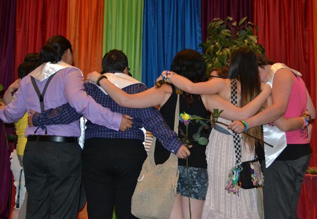Six members of the sorority Gamma Rho Lambda participated in Rainbow Graduation. The graduates and their sorority siblings chant in celebration. Photo credit: John Saringo-Rodriguez / Photo Editor