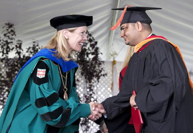 President Harrison congratulates CSUN graduates during the College of Engineering and Computer Science graduation, Wednesday. Photo credit: Loren Townsley / Editor in Chief