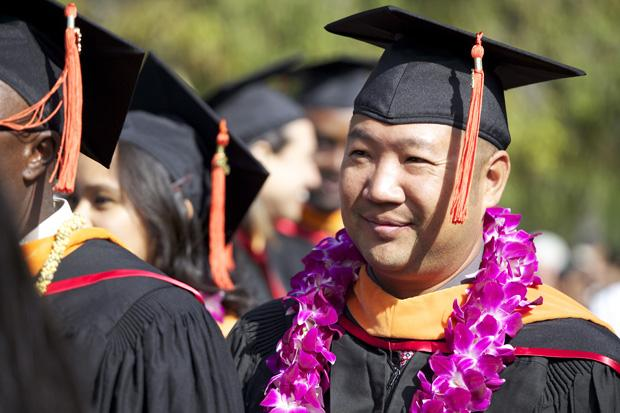 CSUN graduates wait in line to receive their diplomas during the College of Engineering and Computer Science graduation held at the lawn behind Manzanita Hall, Wednesday. Photo credit: Loren Townsley / Editor in Chief