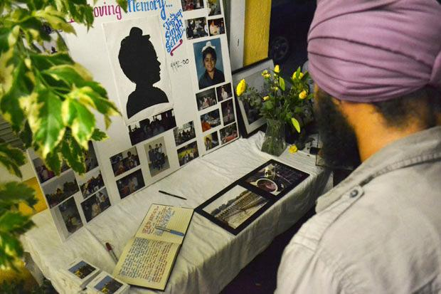 "A memorial was held for Jusdeep ""Peace"" Sethi, 20, junior interdisciplinary major at a Sikh temple in Pacoima on Tuesday, August 13. Family and friends look at a photo collage before entering the temple. Photo credit: John Saringo-Rodriguez / Photo Editor"