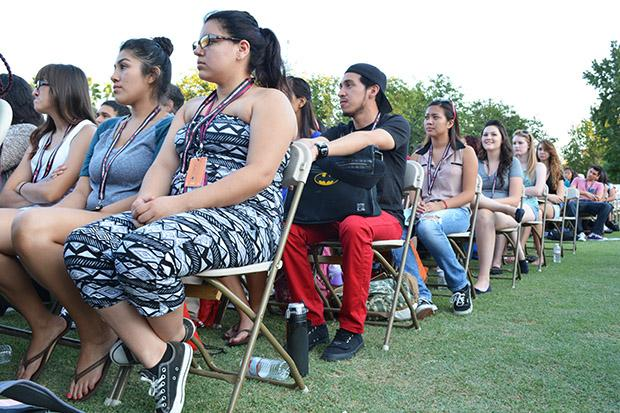 Freshmen wait for the Freshman Convocation to begin. The event took place on Thursday, Sept. 12 at 5 p.m. on the Oviatt lawn.  Photo credit: John Saringo-Rodriguez / Photo Editor