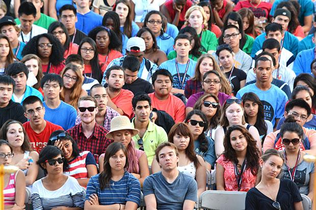 """Attendees at the Annual Freshmen Convocation listened intently to student speaker, Angela Lara Lomeli, a child and adolescent development major who graduated with honors in 2013. Lomeli said, """"brickwalls are there to stop other people not us, we need to defeat them. CSUN is composed of mentors that are always willing to help."""" Photo credit: John Saringo-Rodriguez / Photo Editor"""