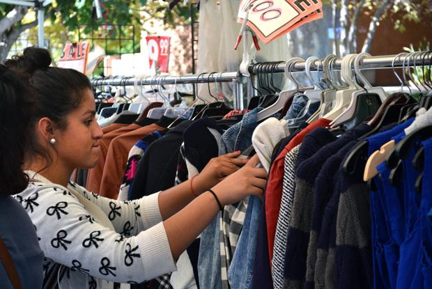 Jennifer Jimenez, 18, freshman, looks for the perfect hoodie to purchase at the Matador Mall located in the front of Bayramian Hall Monday. Photo credit: Victoria Becerril / Daily Sundial
