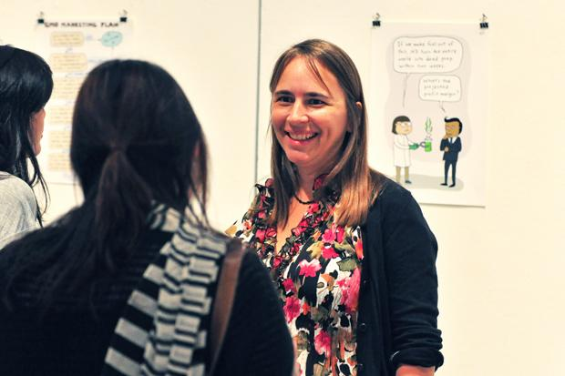Stephanie McMillan, political cartoonist and activist, greeted guests at her opening reception at CSUN's West Gallery Monday night. Photo credit: Luis Rivas / Opinion Editor