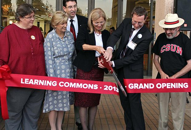 President Dianne F. Harrison and those involved in the planning of the Learning Commons cut the ceremonial ribbon, Thursday, at the Oviatt Library. Photo credit: Lucas Esposito / Daily Sundial