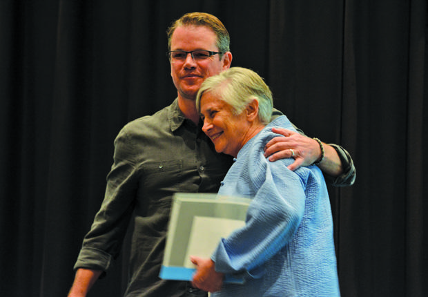"""Matt Damon and Dr. Diane Ravitch embrace at the """"Education on Edge"""" speaker series. Dr. Ravitch an avid advocate for education, spoke of her experiences and promoted her book """"The Reign of Error."""""""