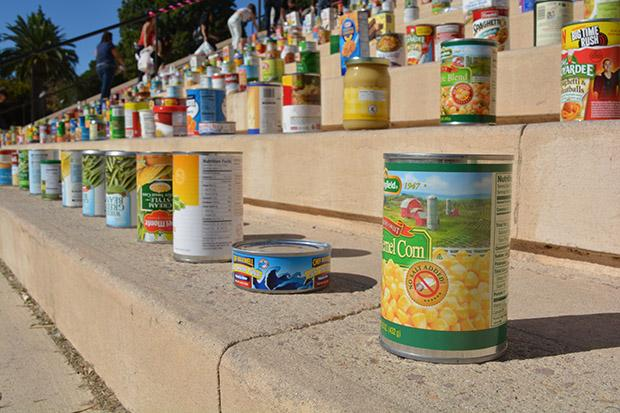 Volunteers lined up non-perishable goods, clothing and toys across the Oviatt Library steps to represent the large amount of donations CSUN has raised. This years clothing and food drive was co-sponsored by Unified We Serve and Community Engagement. Photo credit: John Saringo-Rodriguez / Photo Editor