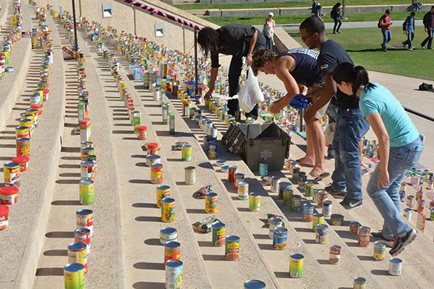 Student volunteers help set up for the Unified We Serve and Community Engagement clothing and food drive Commemorative Ceremony on Nov. 13. Photo credit: John Saringo-Rodriguez / Photo Editor
