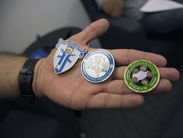 Diaz shows off his challenge coins, which are given to veterans and active service members as proof of particpation in a campaign, battle, group or for outstanding performance. Photo credit: Trevor Stamp / Daily Sundial