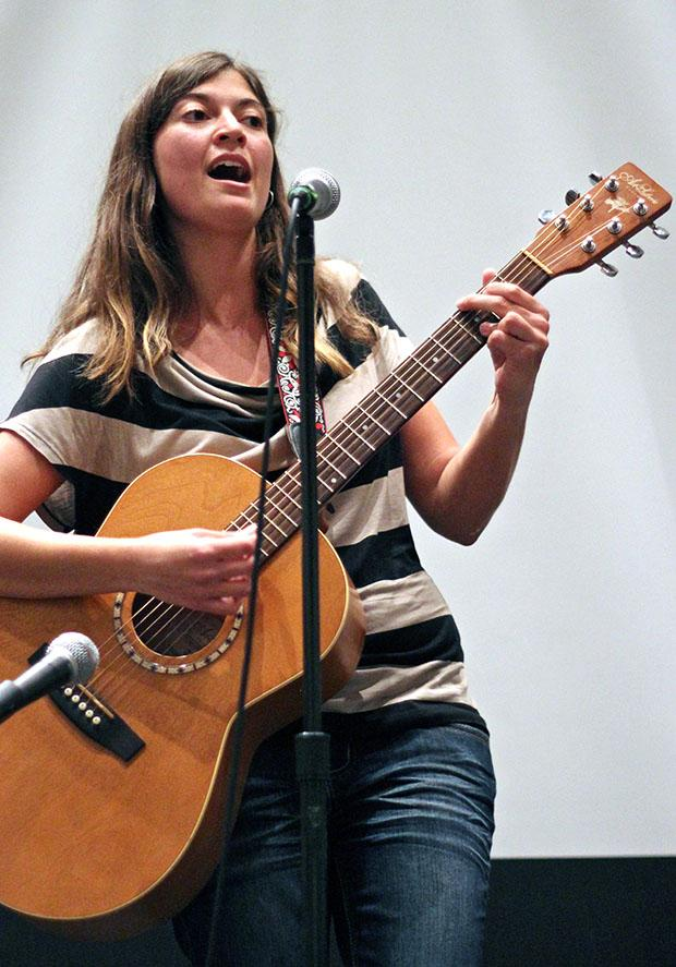 "Liza Hess, 21,a music major, performs a cover of Sara Bareilles' song ""Satellite Call"" during the ""T is No Longer Silent"" talent show hosted by the Pride Center and CSUN's LGBTQA. The event was held at the Northridge Center, Thursday evening. Photo credit: Lucas Esposito / Daily Sundial"