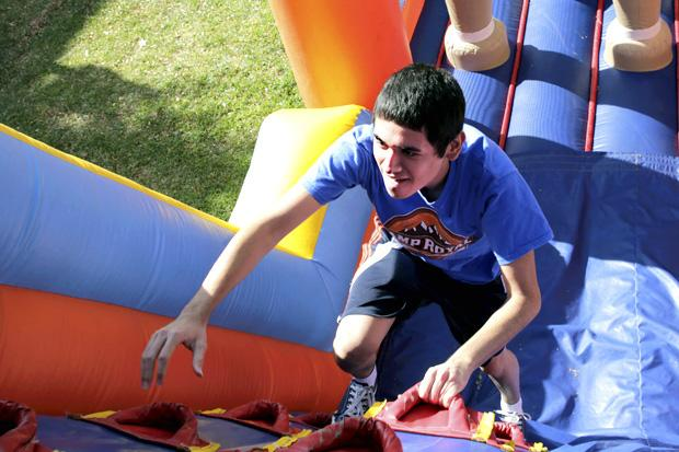 """Alberto Ponce, a music major, participated in the inflatable obstacle course provided by the """"Beat Your Blues"""" event on Monday. The Blues Project, a peer-to-peer group which focuses on depression, will be hosting events throughout the week. Photo credit: Won Choi / Daily Sundial"""