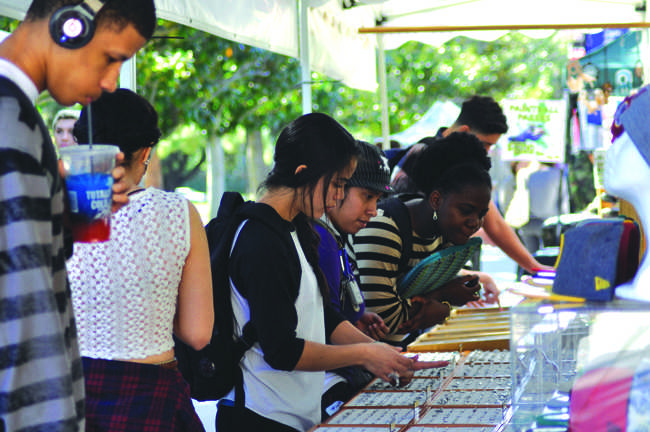 Students look at jewelry available at one of the many booths at Matador Mall in front of Bayramian Hall. Assistant Photo Editor / Ana Rodriguez