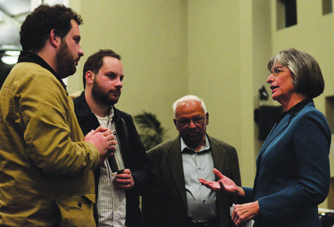 Former Governor Linda Lingle (right) speaks with Adam Morgenstern (far left), 23, senior history major, Michael Morgenstern, 23, and Ram M. Roy, political science professor, after a guest speaker event in the Grand Salon of the USU on Tuesday, Feb. 4.