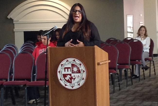 Francesca Vega the director of government and community relations at CSUN talking to the A.S. counsel about how she could offer her assistance at the A.S. meeting on Monday, March 24 at the USU Grand Salon. (Photo Credit: Dache Jackson/Daily Sundial)