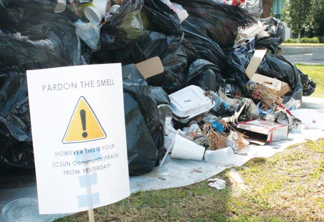 A pile of trash was displayed on the lawn by the Matador Walk displaying the amount of trash students produced the previous day as part of Unified We Serve's Let's Talk TRASH event