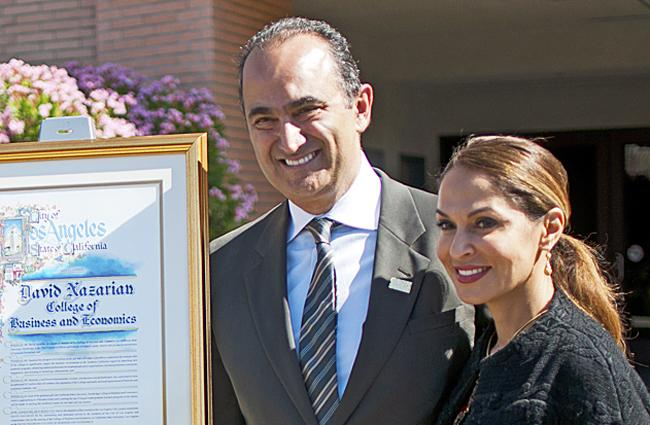 David Nazarian, left, with his wife Angella Nazarian, right, has donated $10 million to the College of Business and Economics which CSUN has now named the college in dedication for his generous support at the naming ceremony on Thursday, March 27, 2014 in Cleary Court in front of Juniper Hall in Northridge, Calif. (Photo Credit: David J. Hawkins/PhotoEditor)