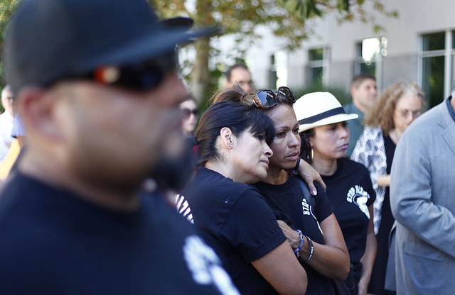 "Maria Castaneda, center, embraces family members while CSUN President Dianne Harrison reads the report on the Pi Kappa Phi fraternity incident in front of University Hall on Sept. 5. ""It provides very few answers, but it's what he would have wanted,"" Castaneda said. Photo Credit: David Hawkins / The Sundial"