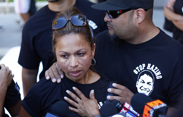Jamie Chastened, Right holds Maria Casteneda, Armando Villa's aunt as she speaks to the press after President Dianne F. Harrison reads the report on the Pi Kappa Phi Fraternity incident at the University Hall on Friday. The fraternity Pi Kappa Phi chapter at CSUN has been forever removed from the university following the death of Armando Villa. (Photo credit: David J. Hawkins/Sundial Staff
