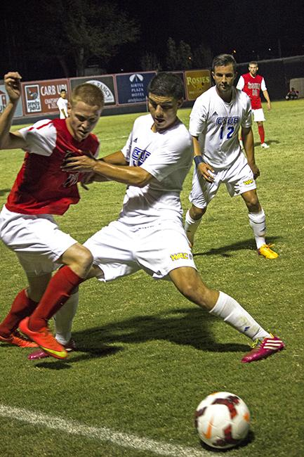 Shane Steffes, defender and midfielder fights with Bakersfield player to take hold of the ball in Friday night's  soccer match against the Bakersfield Roadrunners. Photo Credit: Jessica Boyer/Contributor