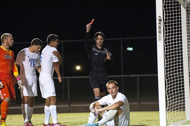 Simon Doherty, center receives the second yellow card resulting a red card forcing him to be ejected from the game. The Matadors win a 2-1 victory over the Roadrunners after enduring a double overtime game ending at the 104th minute mark. Photo Credit: David J. Hawkins/ The Sundial