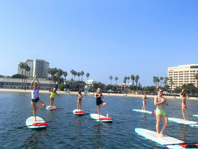 Every weekend, Yogaqua holds classes on paddle boards in Marina Del Rey. Photo courtesy of Yogaaqua.