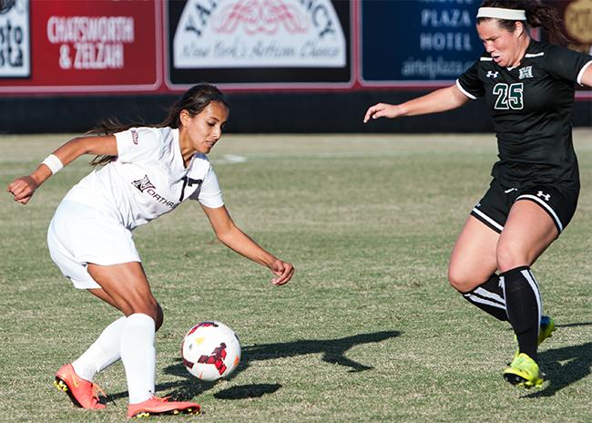 Freshmen Vanessa Mercado, quick on her feet, blows past her opponent in Sundays game against Hawaii on Nov. 2. Photo Credit: Kelly Rosales/ Contributor