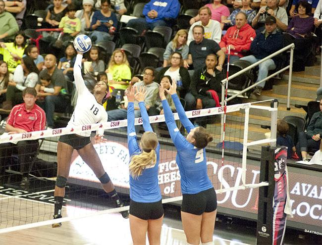 Matadors Danetta Boykin strikes a kill against two UC Santa Barbara Gauchos defenders on Friday, Nov. 14. in Northridge, Calif. Photo Credit: David J. Hawkins/ The Sundial