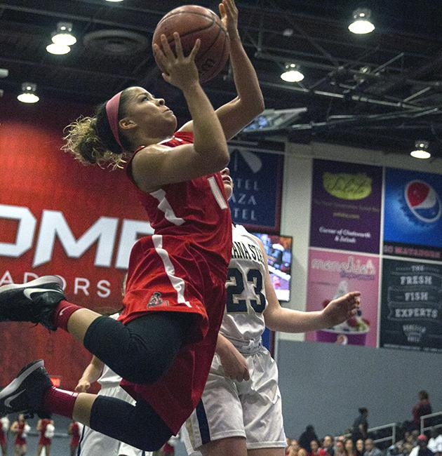 Senior Cinnamon Lister goes airborne for her layup against Montana State during the Matadors' game on Friday night. Lister scored 11 points for the Matadors in their 78-66 win over Montana. Photo Credit: Trevor Stamp/Senior Photographer