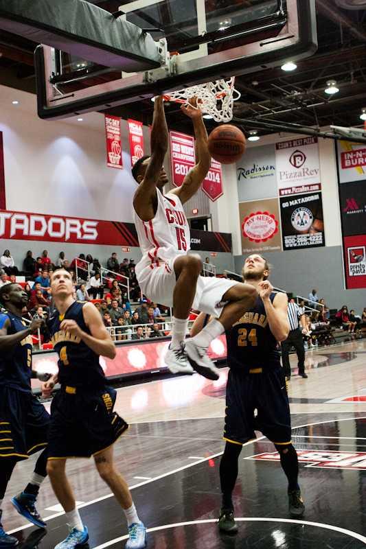 Senior forward Devonte Elliott dunks over the Vanguard Lions in CSUN's 70-58 win on Dec. 6. Elliott finished the game with season-high points and rebounds