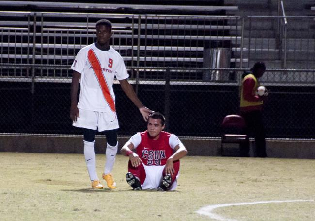 Matadors Victor Vasquez, right, is consoled by CSU Fullerton, Amara Soumah, left at the conclusion of the double overtime at the Matador Soccer Stadium on Wednesday, November 5, 2014 in Northridge, Calif. The tie game prevented the Matadors from advancing to the playoffs that holds the Big West Tournament. (Photo Credit: David J. Hawkins/Sundial)