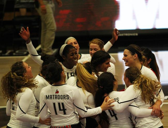 The Matadors earned their post game celebration after sweeping Big West Conference leaders, Hawai'i Rainbow Wahine, in their home opener on Oct. 10, 2014. Photo credit: Trevor Stamp/The Sundial