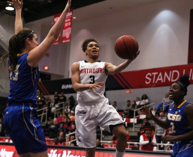 Senior Janae Sharpe powered through UCSB's defense for a layup to help the Matadors in the first half take an early lead on Jan. 15, 2015. Sharpe and the Matadors held on to that lead for a 84-48 win over the Gauchos. Photo credit: Trevor Stamp / Multimedia Editor