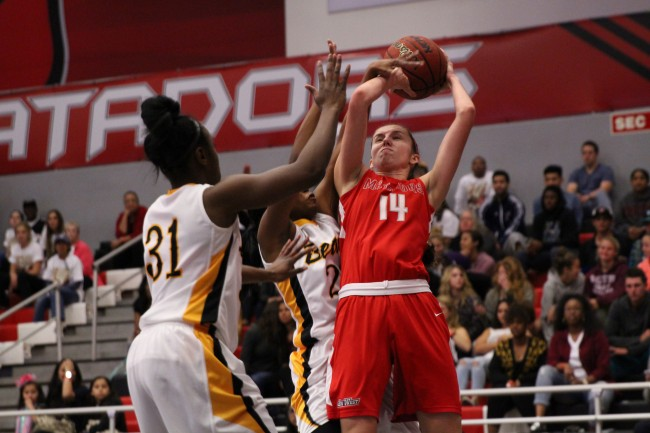 Sophomore Emily Cole gets tangled up as she tries to shoot in the second half for the Matadors in their game against Long Beach on March 5, 2015. Cole scored six points and had four rebounds against Long Beach. (Trevor Stamp / Multimedia Editor)