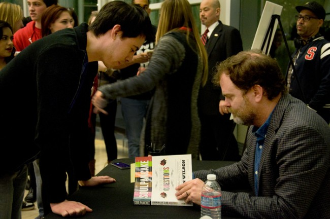 Rainn Wilson signs copies of SoulPancake books sold at the Valley Performing Arts Center for CSUN students. (Cladellain Kae David / Photo Editor)
