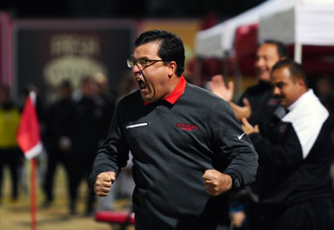 Head Coach Terry Davila celebrates the tying goal with two minutes left in the second half of the payoff game versus UC Davis at Matador Field in Northridge, Calif., on Nov. 7, 2015. The UC Davis Aggies won the game on a golden goal in the first over time and advance to the next round by the final score of 2-1. (Raul Martinez / The Sundial)