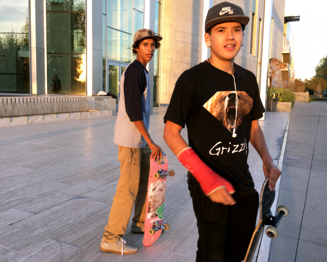 """Mauricio Arana, (left) from Granada Hills and Rick Molina, from Northridge, have """"skating sessions"""" on various parts of campus including the VPAC which they are then told to leave. (Patricia Perdomo / The Sundial)"""