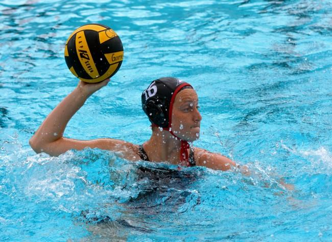 CSUN junior Emily Fuller passes the ball over to her teammates in Matadors game against UC Davis Addies Sunday afternoon. (Patricia Perdomo / The Sundial)