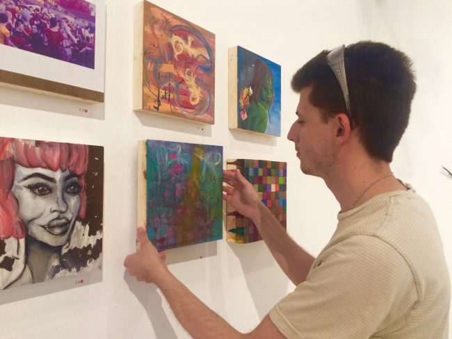 Tanner Gilliland-Swetland fastens panels to the walls inside the West Gallery. As a member of CSUN's sculpture organization, he is responsible for set-up of the program's First Annual Shop and Show Sale. (Lindsay Baffo/The Sundial)
