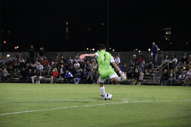 Senior Kevin Marquez is kicking the ball from the goal line to his teammates. Photo Credit: Kendall Faulkner