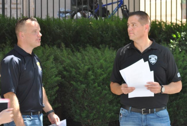 The President of the Statewide University Police Association (SUPA) Jeff Solomon (right) and Officer Matt Kroner (left) hand out flyers to students, informing them of an alleged parking citation quota for CSUN police.