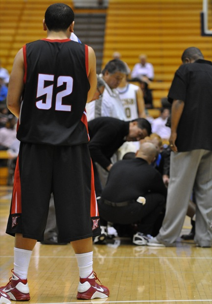 Josh Jenkins looks on as medical staff looks at Rob Haynes, who suffered a concussion in the first half. Jenkins scored 13 points during the Matadors' 72-70 win at UCSB. (Photo by Jonathan Pobre / Photo Editor)