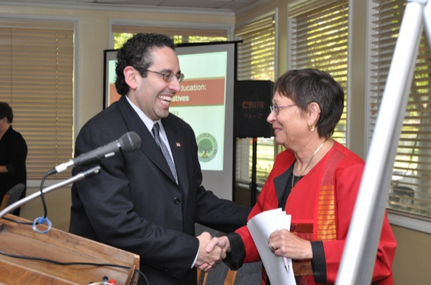 Juan Sepulveda, executive director of the White House Initiative on Educational Excellence for Hispanic Americans, greets President Jolene Koester at the Orange Grove Bistro, Wednesday, Aug. 19, 2009. Photo Credit: Jonathan Pobre / Executive Editor
