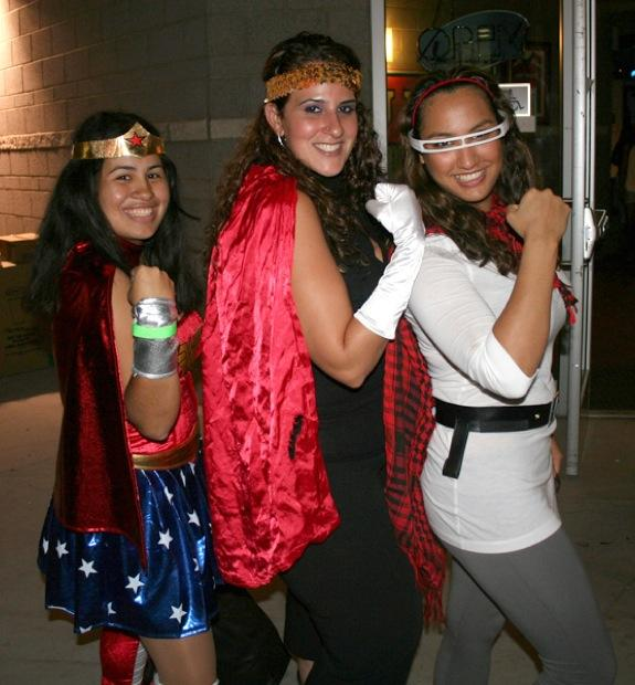 "From left, Siliva Torres, 22; Noffar Kaspi, 23; and Shandiz Kamrava, 21, show off their school spirit in costume at Matador Nights last Friday. Torres came dressed as Wonder Woman, Kaspi appeared as ""Super Noffar,"" and Kamrava was a female Cyclops. Photo Credit:"